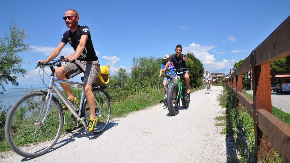 Cycling along the lagoon in Lignano