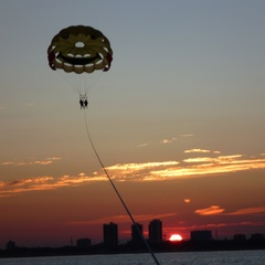 Parasailing at sunset in Lignano